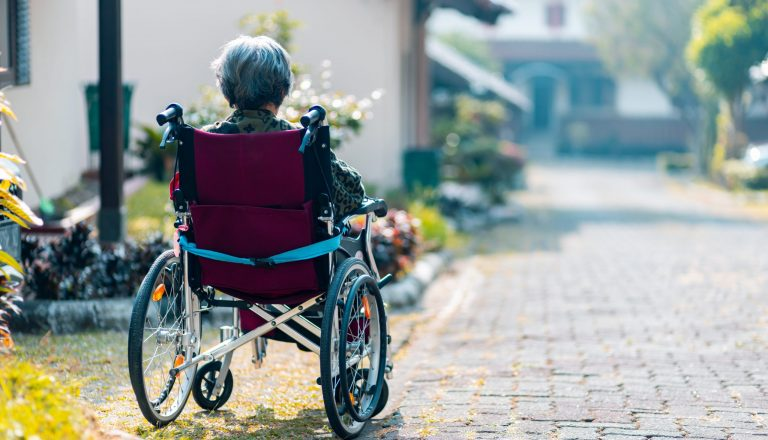 Woman sitting in wheelchair for preventing abuse blog