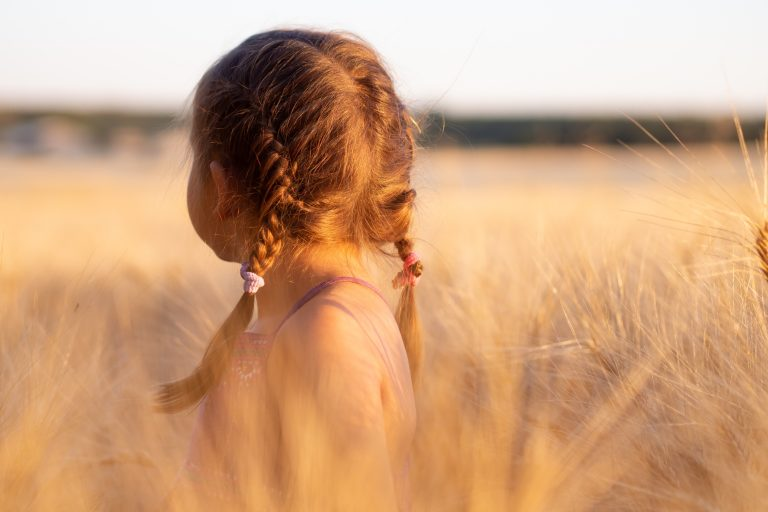 Child in wheat field for child safe blog
