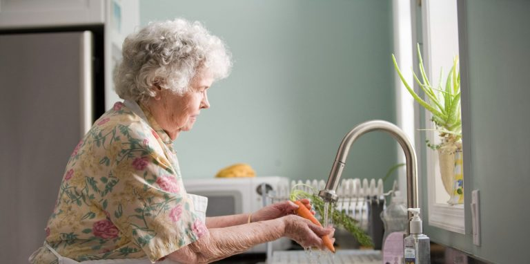 Older woman washing hands